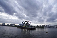 This April 12, 2021, file photo shows the Olympic rings floating in the water in the Odaiba section in Tokyo. (AP Photo/Eugene Hoshiko)
