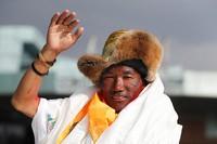 In this May 20, 2018, file photo, Nepalese veteran Sherpa guide, Kami Rita waves as he arrives in Kathmandu, Nepal. (AP Photo/Niranjan Shrestha)