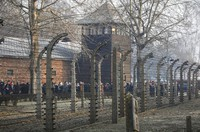 In this file photo taken Jan. 27, 2020, people are seen arriving at the site of the Auschwitz-Birkenau Nazi German death camp, where more than 1.1 million were murdered, in Oswiecim, Poland, for observances marking 75 years since the camp's liberation by the Soviet army. (AP Photo/Czarek Sokolowski)