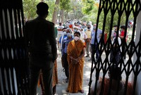 Indians line up to receive the vaccine for COVID-19 at a medical college in Prayagraj, India, on May 8, 2021.  (AP Photo/Rajesh Kumar Singh)