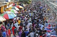 Shoppers crowd at a marketplace in Dhaka, Bangladesh, Friday, May 7, 2021. India's surge in coronavirus cases is having a dangerous effect on neighboring Bangladesh. (AP Photo/Mahmud Hossain Opu)