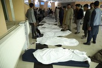 Afghan men try to identify the dead bodies at a hospital after a bomb explosion near a school west of Kabul, Afghanistan, Saturday, May 8, 2021. (AP Photo/Rahmat Gul)