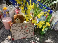 In this April 28, 2021, photo a stuffed bear is among the items left at a street memorial where Honolulu Police shot and killed 16-year-old Iremamber Sykap, whose nickname was Baby, during a car chase on Kalakaua Ave., in Honolulu. (AP Photo/Jennifer Sinco Kelleher)