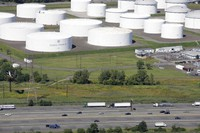 In this Sept. 8, 2008 file photo traffic on I-95 passes oil storage tanks owned by the Colonial Pipeline Company in Linden, N.J. (AP Photo/Mark Lennihan)