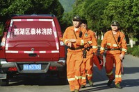 Workers take part in a search for a runaway leopard in Hangzhou in eastern China's Zhejiang province on May 9, 2021. (Chinatopix via AP)