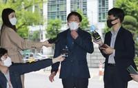 Park Sang-hak, center, speaks to the media upon his arrival at the Seoul Metropolitan Police Agency in Seoul, South Korea, on May 10, 2021. (Hong Hye-in/Yonhap via AP)