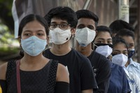 Indian youth above eighteen years age queue up to get vaccinated against the coronavirus in Gauhati, Assam, India, on May 10, 2021. (AP Photo/Anupam Nath)
