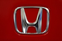 This Feb. 14, 2013, file photo, shows a Honda logo on the trunk of a Honda automobile at the Pittsburgh Auto Show, in Pittsburgh. (AP Photo/Gene J. Puskar)