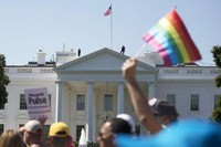 In this June 11, 2017 file photo, Equality March for Unity and Pride participants march past the White House in Washington. (AP Photo/Carolyn Kaster)