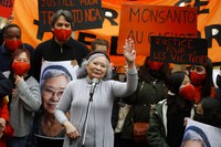 In this Jan.30, 2021 file photo, Tran To Nga waves as she delivers a speech during a gathering in support of people exposed to Agent Orange during the Vietnam War, in Paris. (AP Photo/Thibault Camus)