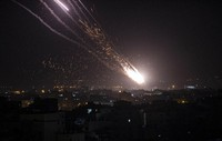 Rockets are launched from the Gaza Strip towards Israel, on May. 10, 2021. (AP Photo/Khalil Hamra)