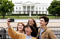 From left, Eliana Lord, Carly Mihovich, Stephanie Justice, and Nick Hansen, visiting from Columbia, S.C., take a photo at Lafayette Park, across the street from the White House, after it reopened in a limited capacity in Washington, on May 10, 2021. (AP Photo/Andrew Harnik)