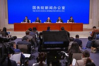Ning Jizhe, center, commissioner of China's National Bureau of Statistics, speaks during a press conference at the State Council Information Office in Beijing, on May 11, 2021. (AP Photo/Mark Schiefelbein)
