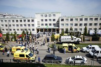 Ambulances and police cars and a truck are parked at a school after a shooting in Kazan, Russia, on May 11, 2021. (AP Photo/Roman Kruchinin)