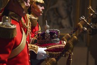 In this Dec. 19, 2019 file photo, the Imperial State Crown, on the three symbols of sovereign power, arrives at the Norman Porch for the State Opening of Parliament at the Houses of Parliament in London. (Ben Stansall/Pool Photo via AP)