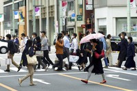 People wearing protective masks to help curb the spread of the coronavirus walk along a pedestrian crossing on Wednesday, May 12, 2021, in Tokyo. (AP Photo/Eugene Hoshiko)