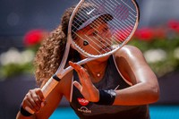 Japan's Naomi Osaka returns the ball to Japan's Misaki Doi during their match at the Mutua Madrid Open tennis tournament in Madrid, Spain, on April 30, 2021. (AP Photo/Bernat Armangue)