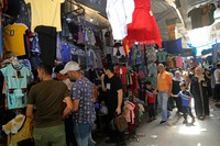 Iraqis buy clothes in preparation for the Muslim holiday of Eid al-Fitr, which marks the end of the holy fasting month of Ramadan, at the Shorjah market in central Baghdad, Iraq, on May 11, 2021. (AP Photo/Hadi Mizban)