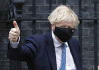 Britain's Prime Minister Boris Johnson leaves 10 Downing Street for a debate on the Queen Speech at House of Commons in London, on May 12, 2021. (AP Photo/Alastair Grant)