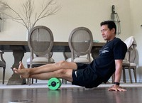 Yutaka Nakamura is seen placing the injured part of his body on a foam roller and applying his own body weight as much as possible. (Photo courtesy of Yutaka Nakamura)