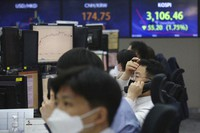 A currency trader talks on the phone at the foreign exchange dealing room of the KEB Hana Bank headquarters in Seoul, South Korea, on May 13, 2021. (AP Photo/Ahn Young-joon)