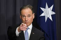 Australia's Health Minister Greg Hunt speaks to the media during a press conference at Parliament House in Canberra, on May 13, 2021. (Lukas Coch/AAP Image via AP)