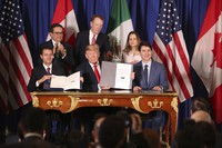 In this Nov. 30, 2018 file photo, then U.S. President Donald Trump, center, sits between Canada's Prime Minister Justin Trudeau, right, and Mexico's President Enrique Pena Nieto after they signed a new United States-Mexico-Canada Agreement that is replacing the NAFTA trade deal, during a ceremony at a hotel before the start of the G20 summit in Buenos Aires, Argentina. (AP Photo/Martin Mejia)
