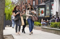 In this May 2, 2021, file photo, pedestrians walk along Boston's fashionable Newbury Street. (AP Photo/Steven Senne)