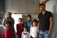 Abdul Salam Al Khawien, 37, right, and his wife Kariman, 32, left, pose with their children for a family photo, at their apartment in the northern city of Thessaloniki, Greece, on May 1, 2021. (AP Photo/Giannis Papanikos)