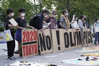 People against the Tokyo 2020 Olympics are seen around Tokyo's National Stadium during an anti-Olympics demonstration on May 9, 2021. (AP Photo/Eugene Hoshiko)