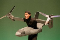 "Masamitsu Kohatsu, known more commonly as Maachan, plays the role of U.S. transport aircraft Osprey in a skit in the 2020 performance of ""Owarai Beigun Kichi"" (Jokes about U.S. military bases). (Photo Courtesy of FEC Office Inc.)"