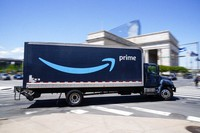 An Amazon truck drives in in Philadelphia, on April 30, 2021. (AP Photo/Matt Rourke)