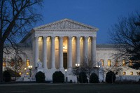 In this Jan. 22, 2020, file photo, night falls on the Supreme Court in Washington. (AP Photo/J. Scott Applewhite)
