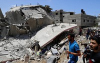 People inspect the rubble of a destroyed residential building which was hit by Israeli airstrikes, in Gaza City, on May 12, 2021. (AP Photo/Adel Hana)