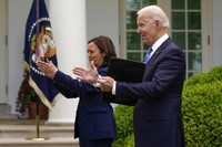 President Joe Biden claps with Vice President Kamala Harris after speaking on updated guidance on face mask mandates and COVID-19 response, in the Rose Garden of the White House, on May 13, 2021, in Washington. (AP Photo/Evan Vucci)