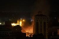 Smoke rises following Israeli missile strikes on Gaza City, on May 14, 2021. (AP Photo/Khalil Hamra)