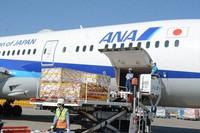A shipment of coronavirus vaccines is seen being unloaded from an All Nippon Airways flight from Belgium, at Narita Airport in Narita, Chiba Prefecture, on Feb. 21, 2021. (Mainichi/Tadakazu Nakamura)