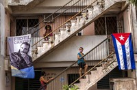 People wait to be vaccinated with the Cuban Abdala vaccine for COVID-19 at a doctors' office, decorated with an image of Fidel Castro and a Cuban flag, in the Alamar neighborhood of Havana, Cuba, on May 14, 2021. (AP Photo/Ramon Espinosa)