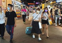 People wear face masks to protect against the spread of the coronavirus at a night market in Taipei, Taiwan, on May 14, 2021. (AP Photo/Chiang Ying-ying)