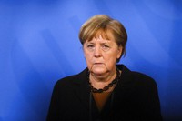 In this March 30, 2021 file photo, German Chancellor Angela Merkel briefs the media after a virtual meeting with federal state governors at the chancellery in Berlin, Germany. (AP Photo/Markus Schreiber, Pool)