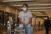 Yuki Kitazumi speaks to reporters upon his arrival at Narita airport on the night of May 14, 2021. (Mainichi)