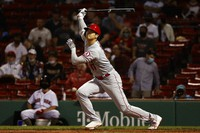 Los Angeles Angels' Shohei Ohtani watches his solo home run against the Boston Red Sox during the sixth inning of a baseball game on May 14, 2021, at Fenway Park in Boston. (AP Photo/Winslow Townson)