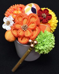 """An Arenca series package containing """"tsumami-kanzashi"""" traditional hair ornaments, which resembles a bouquet, is seen at Sugino Shoten store in Tokyo's Sumida Ward on March 4, 2021. (Mainichi/Hiroshi Maruyama)"""