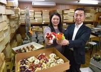 Mamoru Sugino, right, and his wife Satoko are seen at Sugino Shoten store in Tokyo's Sumida Ward on March 4, 2021. (Mainichi/Hiroshi Maruyama)
