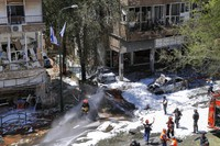 Israeli security forces and emergency services work on a site hit by a rocket fired from the Gaza Strip, in Ramat Gan, central Israel, on May 15, 2021. (AP Photo/Oded Balilty)