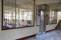 In this photo released by Department of Corrections, COVID-19 prisoners sit inside a field hospital set up at Medical Correctional Institution to treat COVID-19 inmates, in Bangkok, Thailand, on May 8, 2021. (Department of Corrections, Thailand via AP)