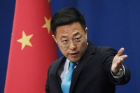 In this Feb. 24, 2020, file photo, Chinese Foreign Ministry spokesperson Zhao Lijian gestures as he speaks during a daily briefing at the Ministry of Foreign Affairs office in Beijing. (AP Photo/Andy Wong)