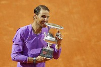Spain's Rafael Nadal celebrates with the trophy after winning the Italian Open tennis tournament, in Rome, on May 16, 2021. Nadal defeated Serbia's Novak Djokovic 7-5, 1-6, 6-3. (AP Photo/Gregorio Borgia)
