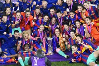Barcelona players pose for a photograph with the trophy after the UEFA Women's Champions League final soccer match between Chelsea FC and FC Barcelona in Gothenburg, Sweden, on May 16, 2021. Barcelona won 4-0. (AP Photo/Martin Meissner)