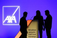 In this Feb. 21, 2019, file photo, people stand in front of the logo of AXA Group prior to the company's 2018 annual results presentation, in Paris. (AP Photo/Thibault Camus)